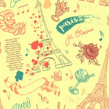 Paris. Vintage seamless pattern with Eiffel Tower, flowers, feathers, cocktails and text. Royalty Free Stock Photos