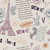 Paris. Vintage seamless pattern with Eiffel Tower, flowers, feathers and text.  Stock Photo