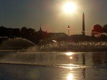 Sunset on the Obelisk Concorde in Paris with Sepia effect and Water Jet. Paris Water Jet at the end of the day - Pairs Concorde Obelisk Royalty Free Stock Photos