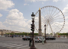 The Paris wheel on the Place de la Concorde. By area moving veh Royalty Free Stock Images