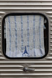 Paris Window. Streamlined Car Door with parisian sign dishcloth in the window Royalty Free Stock Photo