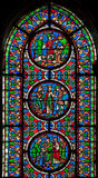 Paris - The windowpane from Saint Denis gothic church with the scenes from French history. stock photos