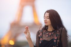 Free Paris Woman Smiling Eating The French Pastry Macaron In Paris Against Eiffel Tower. Royalty Free Stock Image - 113922136