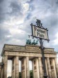 Pariser Platz Sign in Berlin and Brandenburger Gate Stock Photos