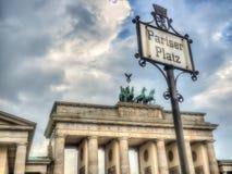 Pariser Platz Sign in Berlin and Brandenburger Gate Royalty Free Stock Photos