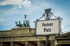 Pariser Platz street sign in Berlin, Germany with Brandenburg gate behind Stock Photos