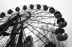 Pariserhjul i nöjesfält i övergiven spökstad av Pripyat, Tjernobyl uteslutandezon, Ukraina arkivfoto
