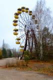 Pariserhjul i nöjesfält i död övergiven spökstad av Pripyat, Tjernobyl uteslutandezon, Ukraina arkivfoto
