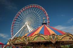 Pariserhjul och karusell Fotografering för Bildbyråer
