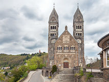 Parish Church in Clervaux. CLERVAUX, LUXEMBOURG - APRIL 26, 2014: Parish Church in Clervaux on a cloudy day Royalty Free Stock Image