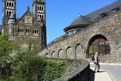 Parish Church in Clervaux. Tourist walking to the entrance of the Parish Church from 1910 in Clervaux, luxembourg Stock Image