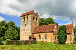 Parish church, Fingest, Buckinghamshire, England. Parish church of St. Bartholomew in Fingest village of Buckinghamshire, England with blue skies and grey clouds Stock Images