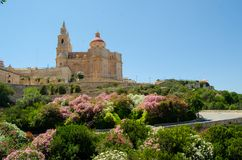 Parish Church of Mellieha, Malta, on summer. Parish Church of Mellieha, Malta, sumer time, surrounded by flowers Stock Photo