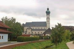 The parish church in Obertrum, Austria. The parish church in Obertrum, a small town in Salzburger Land, Austria. Inscription on the yellow traffic sign royalty free stock photo
