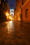 Parish church and paved street Stock Images