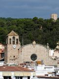 The Parish Church of Sant Vicent and a fortress tower in Tossa d. E Mar, Spain Royalty Free Stock Photos
