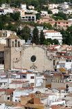 The Parish Church of Sant Vicent surrounded by roofs - Tossa de. Mar, Catalonia Royalty Free Stock Image
