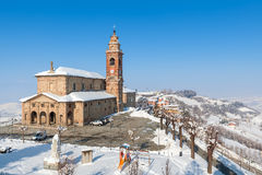 Parish church and snowy hills in Italy. Royalty Free Stock Image