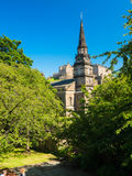 Parish Church of St Cuthbert. With Edinburgh Castle and blue sky in the background. One week before the start of the 70th Edinburgh Festival. Best time of year Royalty Free Stock Photography