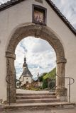 Parish church St. Sebastian in Ramsau. Editorial: RAMSAU, BAVARIA, GERMANY, September 26, 2017 - Parish church St. Sebastian in Ramsau seen through the gate of Royalty Free Stock Images