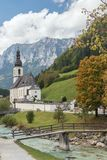 Parish church St. Sebastian with the Ramsauer Ache. And the Reiter Alpe in background Royalty Free Stock Image