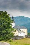 Parish Church sv.Nikolaja in Sorica, Slovenia. Misty day in mountains royalty free stock photography
