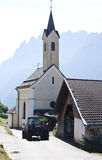 Parish church and tractor in Dorfl, Austria Stock Photo
