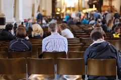 Parishioners gather for Mass. At St Paul`s Cathedral In London, UK stock photography