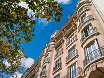 Parisian Apartments. This midday shot of the upper floors of an apartment building was taken in Paris, France Royalty Free Stock Photo