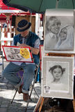 Parisian Artist Drawing a Caricature in Montmartre of Paris Stock Photos
