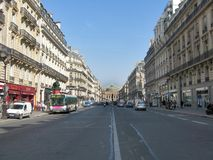 Parisian avenue. With the opera house on the background royalty free stock image