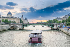 Parisian bateau on the Seine river at sunset.  Royalty Free Stock Photography