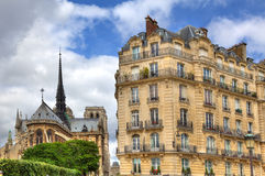 Parisian building and Notre Dame de Paris. Stock Image