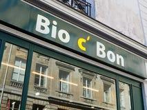 A parisian building reflects into a shop window. PARIS, FRANCE - JUNE 29, 2018: An Haussmanian-style building reflects into Bio C` Bon shop window on June 29 stock image