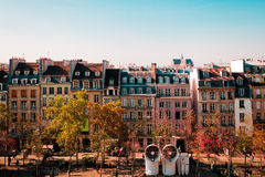 Parisian buildings in front of Centre Pompidou in Paris, France Royalty Free Stock Photo