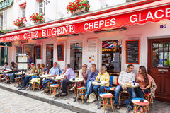 Parisian Cafe. Unidentified patrons relaxing at a cafe in Montmartre in Paris Royalty Free Stock Photo