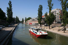 Parisian canal. A boat on Saint-Martin's canal in Paris, France Royalty Free Stock Photos
