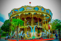 Parisian carousel at the City Hall of Paris France. With many colours and people Stock Images