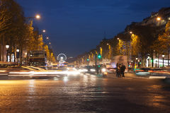 Parisian Champs Elysees in evening,. Evening time in avenue Champs Elysees, Paris, France stock images