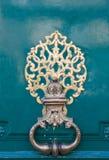 Parisian door. A bronze handle of a wooden door in Paris, France stock photo