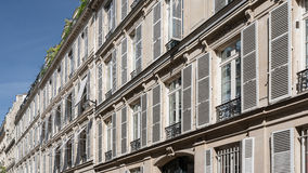 Parisian facades. Plaster or stone, wood or brick facades of Parisian buildings tell the story of the capital Stock Photos