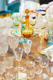 Parisian flea market. Crystal pitcher and glasses on a Parisian flea market Royalty Free Stock Images