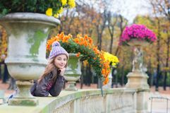 Parisian girl in the Gardens of Luxembourg Stock Photos