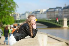 Parisian girl at the Seine embankment Stock Images