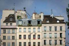 Parisian houses and rooftops on the Left Bank, Par. Row of typical Parisian buildings along the River Seine in the Sorbonne neighborhood. Paris, France Royalty Free Stock Photos