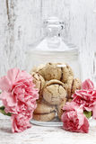 Parisian macarons among pink carnation flowers. Festive and party dessert Stock Photography