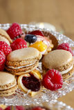 Parisian macarons, raspberries and other delicacy Stock Photo