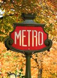 Parisian metro sign. With autumn trees in the background Stock Photo