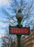 Parisian metro sign. Against a bare tree and wintery blue sky Stock Image