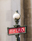 Parisian metro sign with a lamppost against  vintage wall Royalty Free Stock Photography